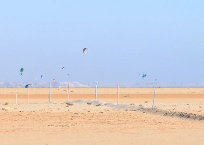 Kites around sand dunes