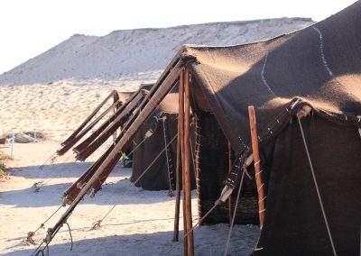 Exterior Close up photo of berber tents surrounded by Sand Dunes at Dakhla Kitesurf World Hotel
