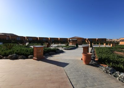 Entrance showing vegetation surrounding lounge area with casual bar and frontline lagoon view Deluxe Bungalows which are surrounded by Sand Dunes at Dakhla Kitesurf World Hotel