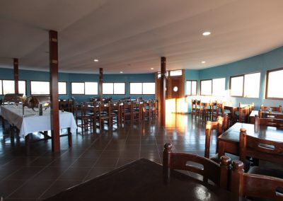 Interior Photo of the restaurant with 3 sides windows offering a beautiful view of lagoon and surroundings at the Dakhla Kitesurf World