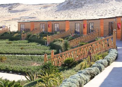 Bungalows surrounded by Sand Dunes