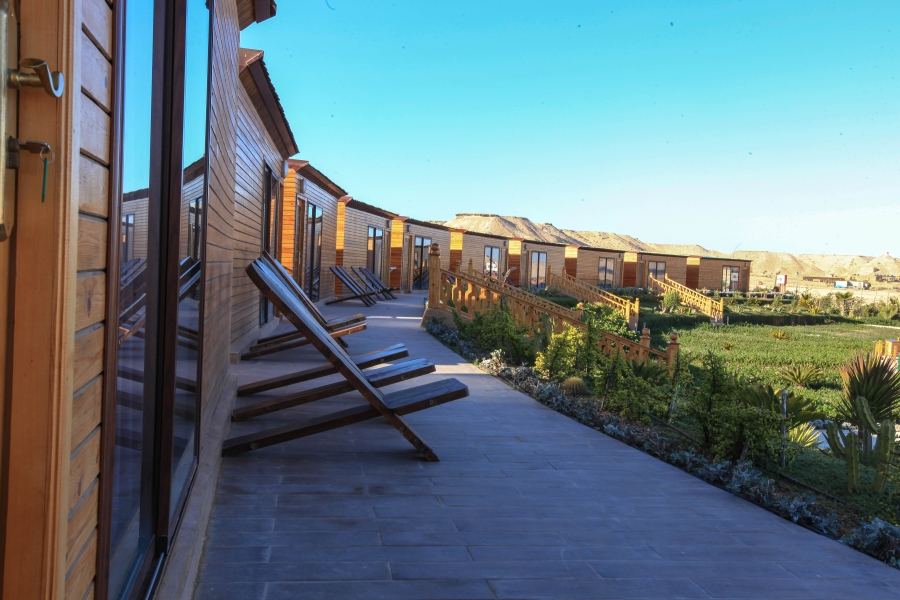 Beautiful garden by the terraces of Frontline and lagoon-view Bungalows at Dakhla Kitesurf World Hotel which is surrounded by sand dunes